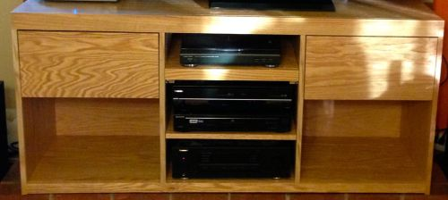 Closeup of the cabinet and the equipment.  The top shelf is a pull out shelf with a turntable.  We just love our vinyl records.