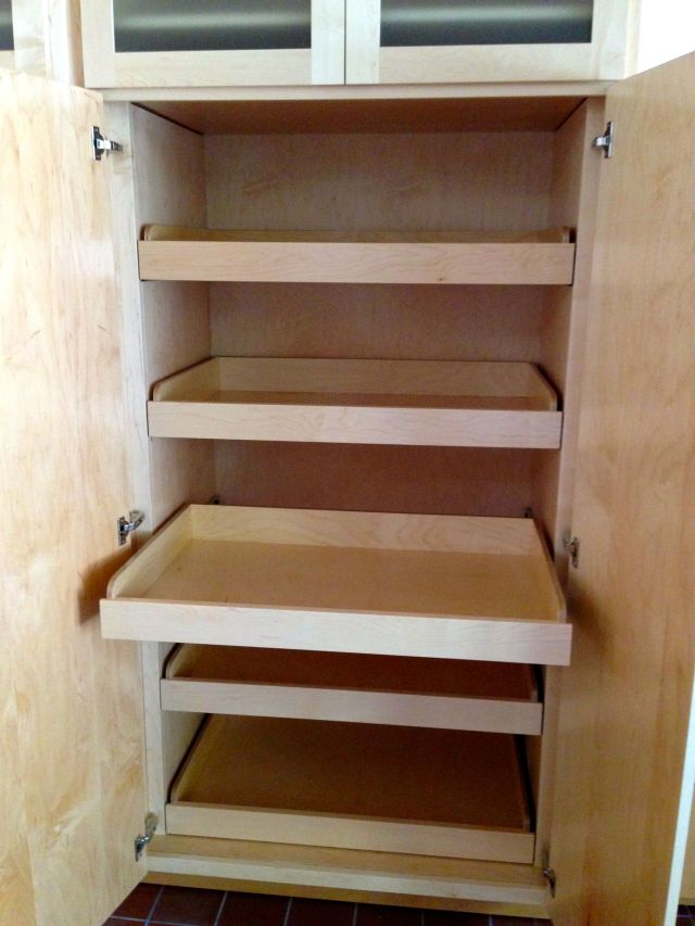 The pantry cupboard with all pullout shelving.