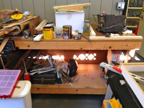 Here is the outside work bench with all it's junk.  There will be 6 new pullout shelves to store and organize this stuff.