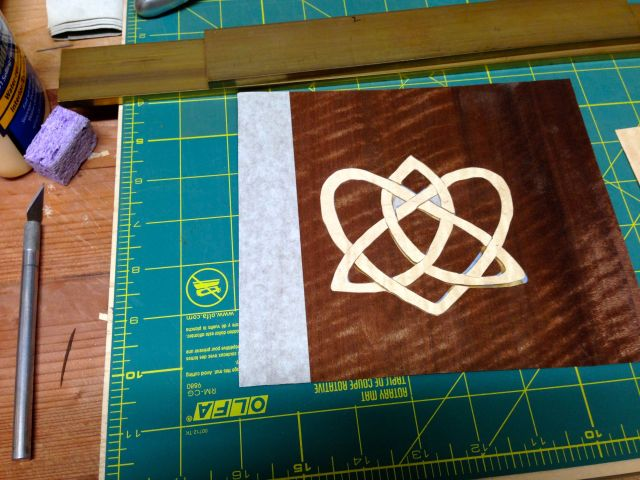 The cut marquetry.  Next step is to glue it down