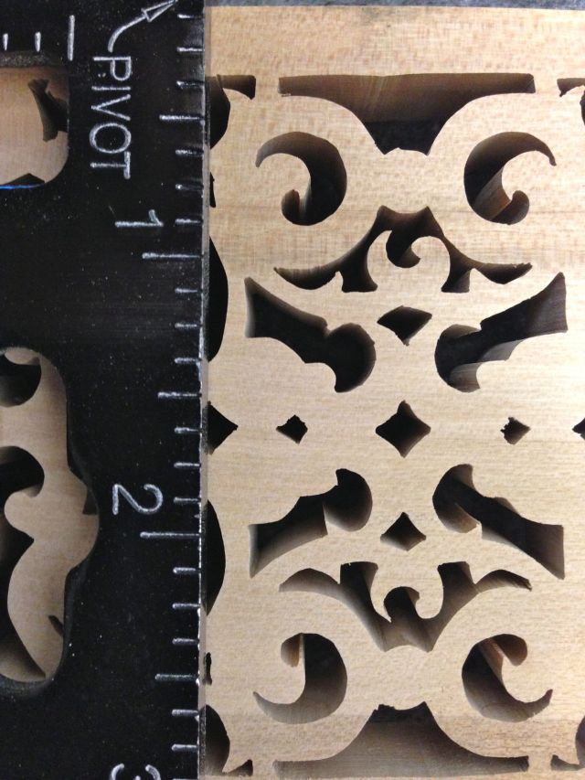 Extreme closeup of the fretwork.  The scale is in inches.  Yes most of the holes are smaller than your finger nail.