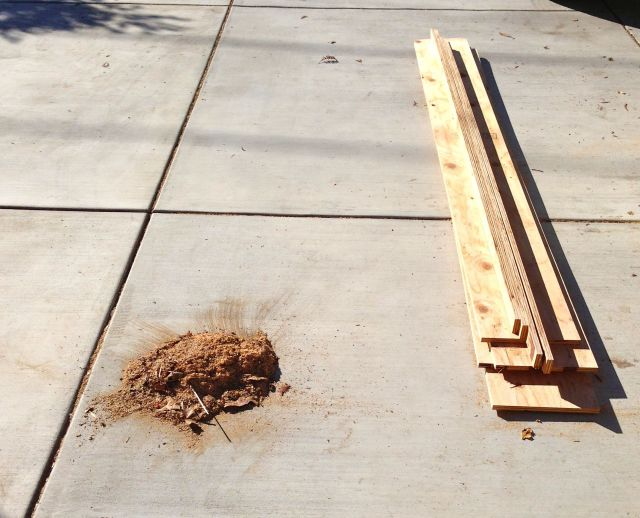 The total output of an hour's work: One pile of plywood and one pile of sawdust.