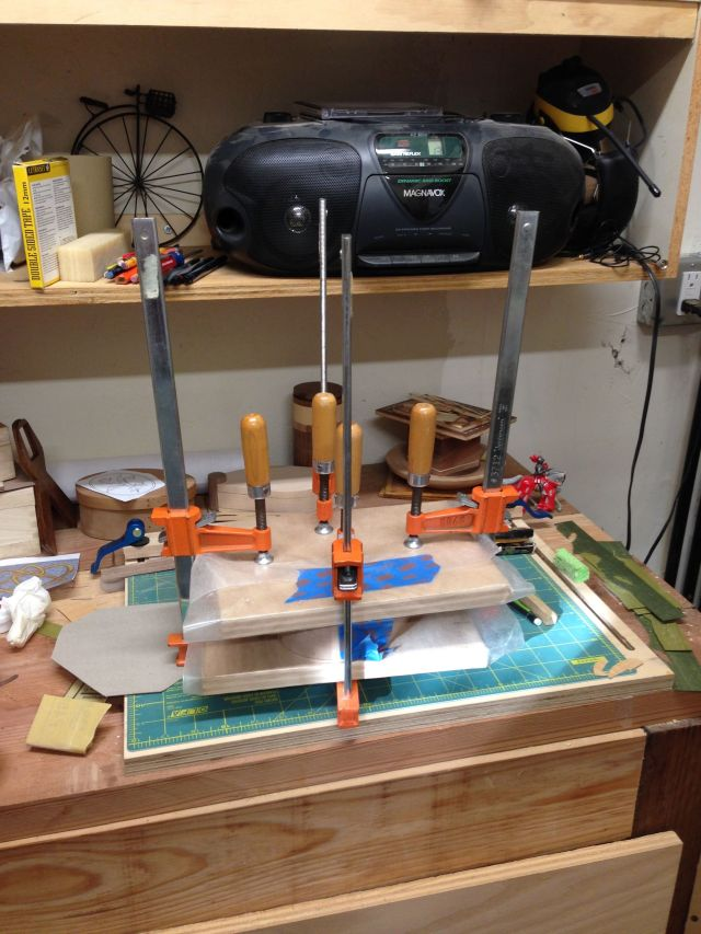 The box in clamps during the gluing process.