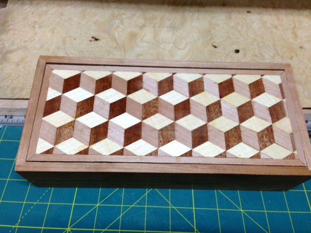 Parquetry finished. The cubes have a cherry veneer boarder.