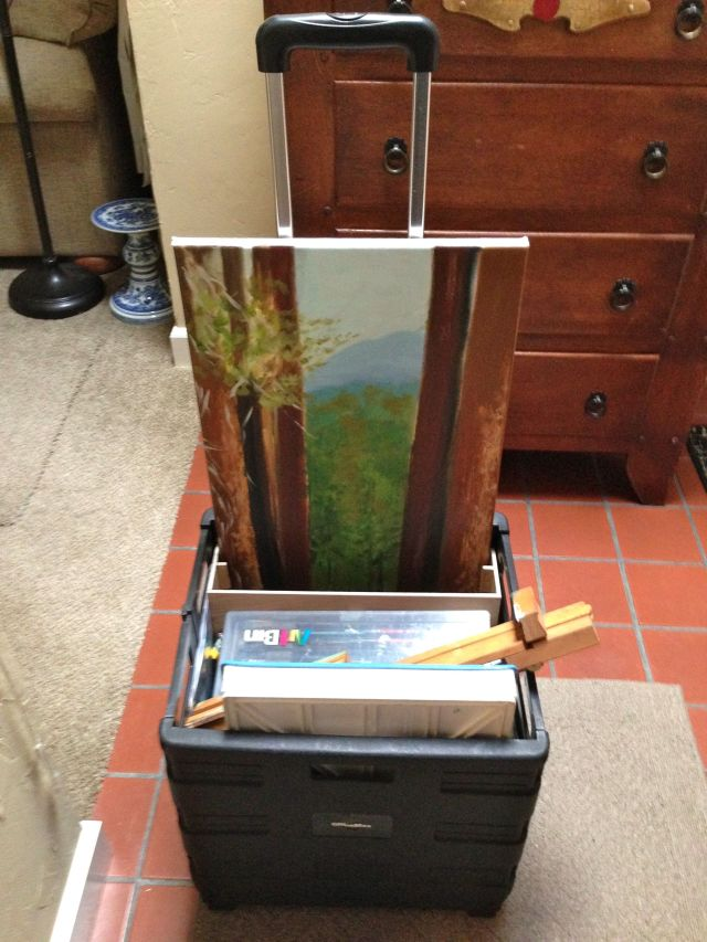 Here's the little pull cart with all her supplies and a painting she's working on.