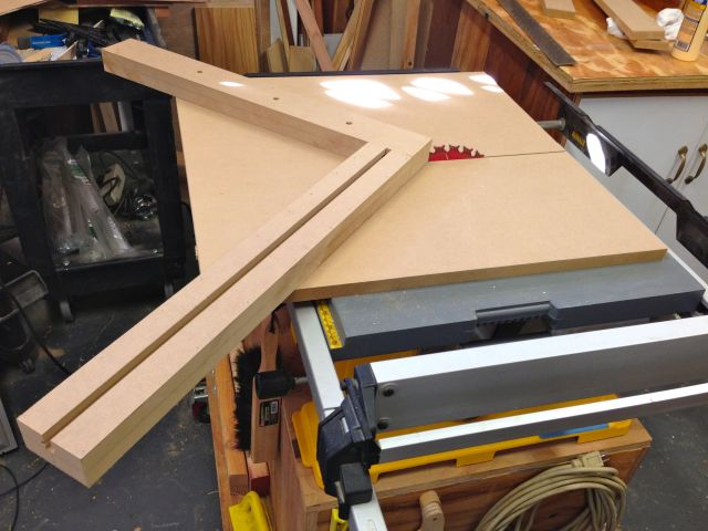 The miter sled fits on the table saw to cut the 45 degree angle.  This isn't fully complete as it still needs a few more parts.