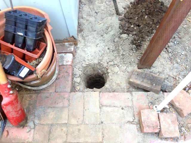 Second post hole.  Four to go.