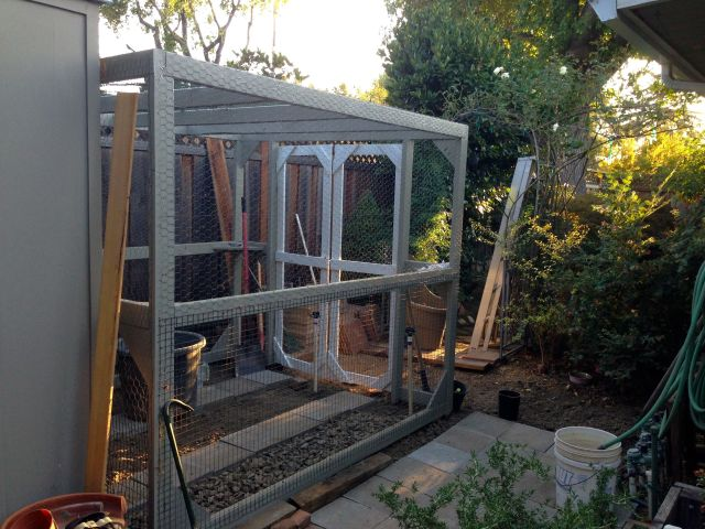 Cage doors, built, installed, primed, latched and ready to keep critters out.