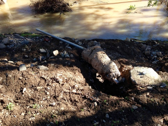 The flood took out about 20 feet of chainlink fence.  This post was just lifted out of the ground.