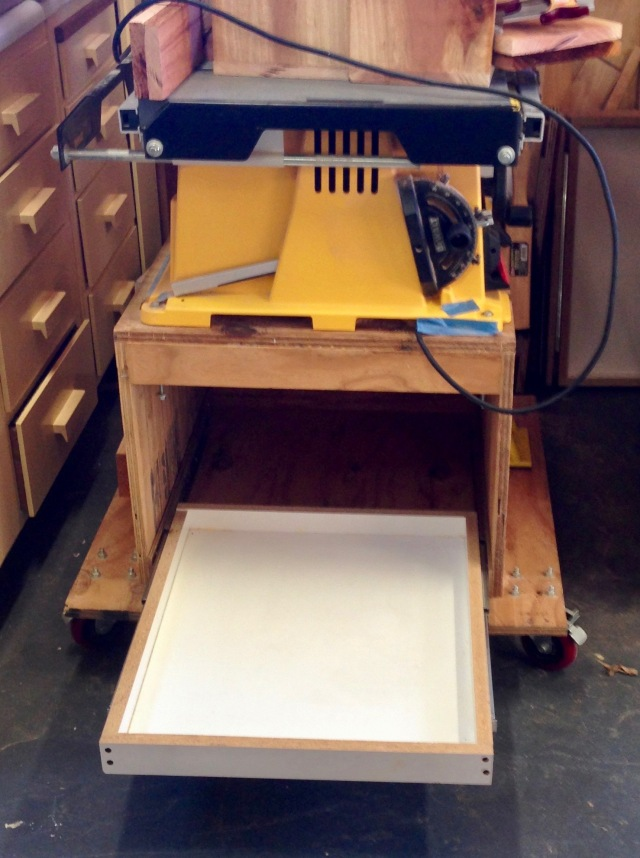 Pull out storage for the table saw stand.