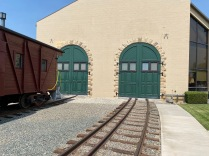 One of the big doors that lets trains go into the museum building for display. The three rails allow for standard and narrow gage trains to be put on display.